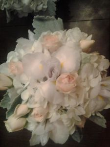 A beautiful mix of Iris, Spray Roses, Hydrangea and Dusty Miller